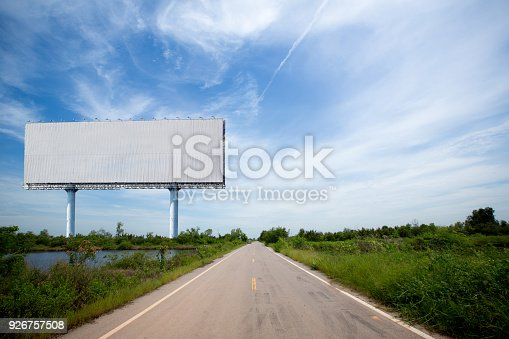 istock blank billboard on the sideway in the park. image for copy space 926757508