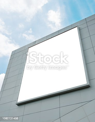 Blank billboard on the wall of shopping mall.