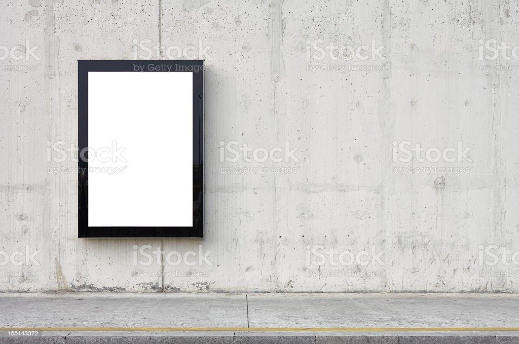 Blank billboard on wall. stock photo