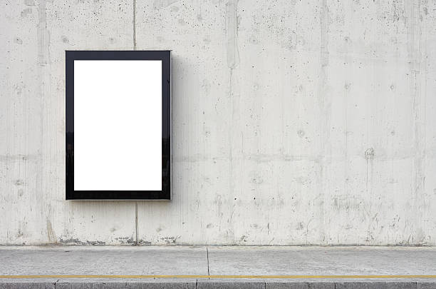 blank billboard on wall. - poster stock pictures, royalty-free photos & images