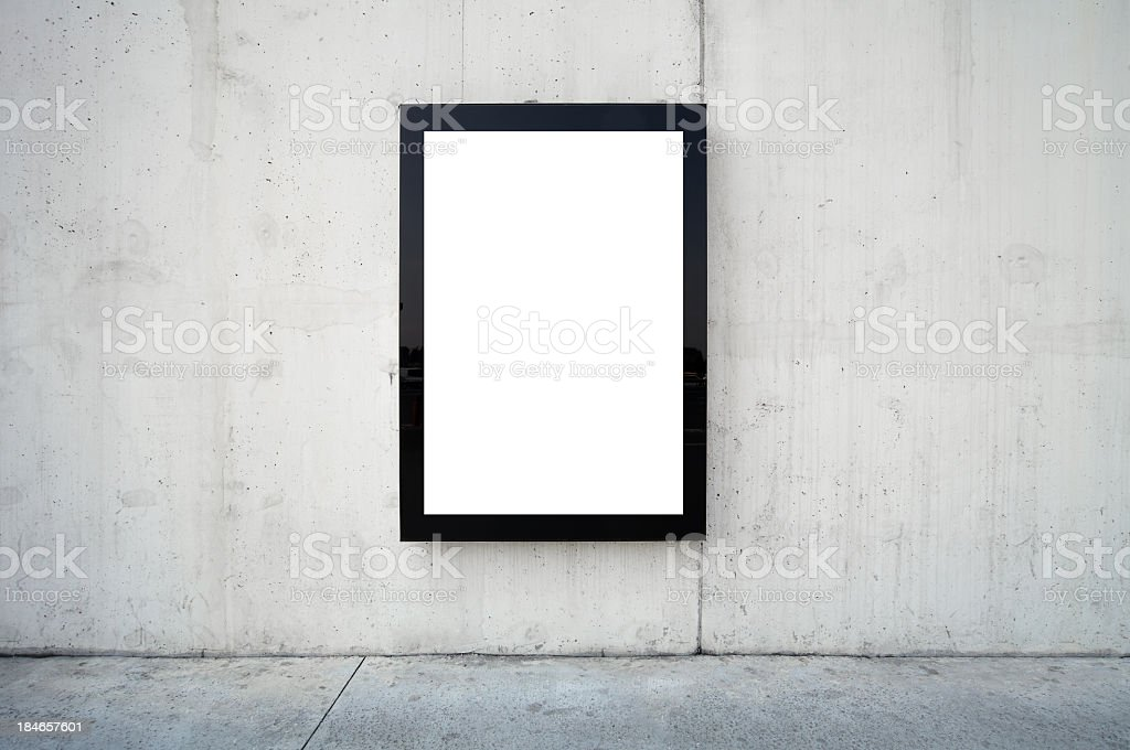 Blank billboard on wall. stock photo
