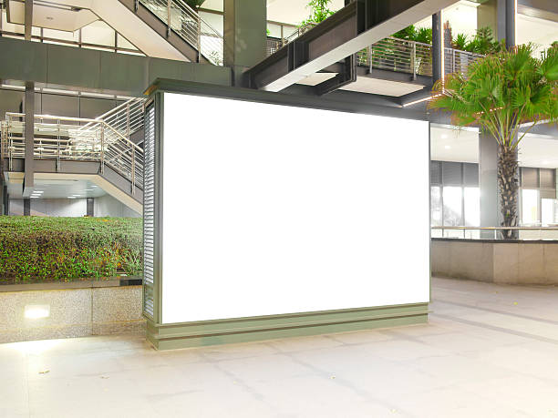 Blank billboard Blank billboard in modern building electronic billboard stock pictures, royalty-free photos & images