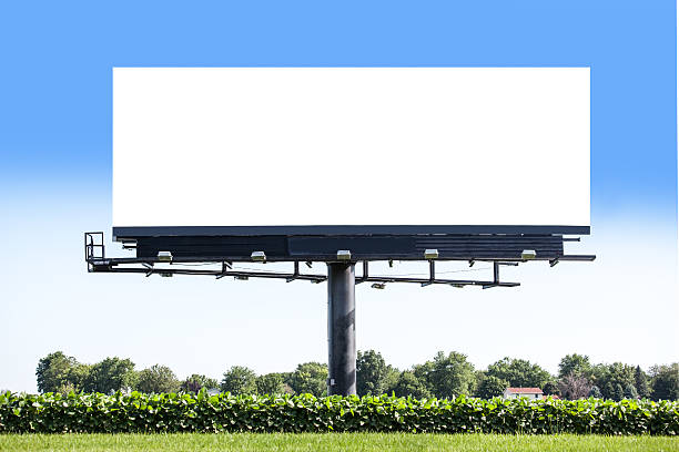 Blank Billboard Blank billboard standing in a soybean field along a road. billboard stock pictures, royalty-free photos & images