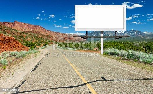 istock Blank Billboard Sign by Highway in Desert 517163860