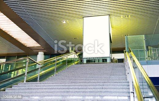 Blank billboard standing on stairway entrance.
