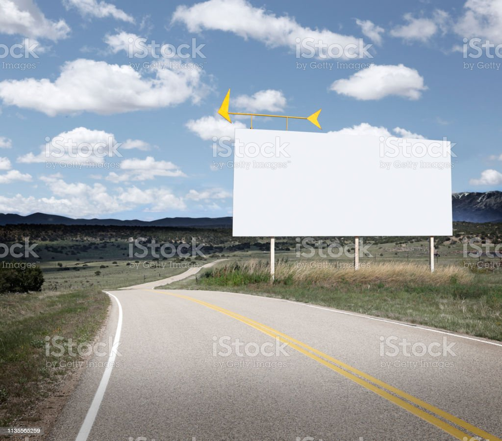 Blank Billboard Stands Along A Winding Rural Road stock photo