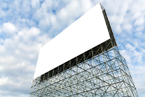 blank billboard with cloud and blue sky used for advertising, public relations