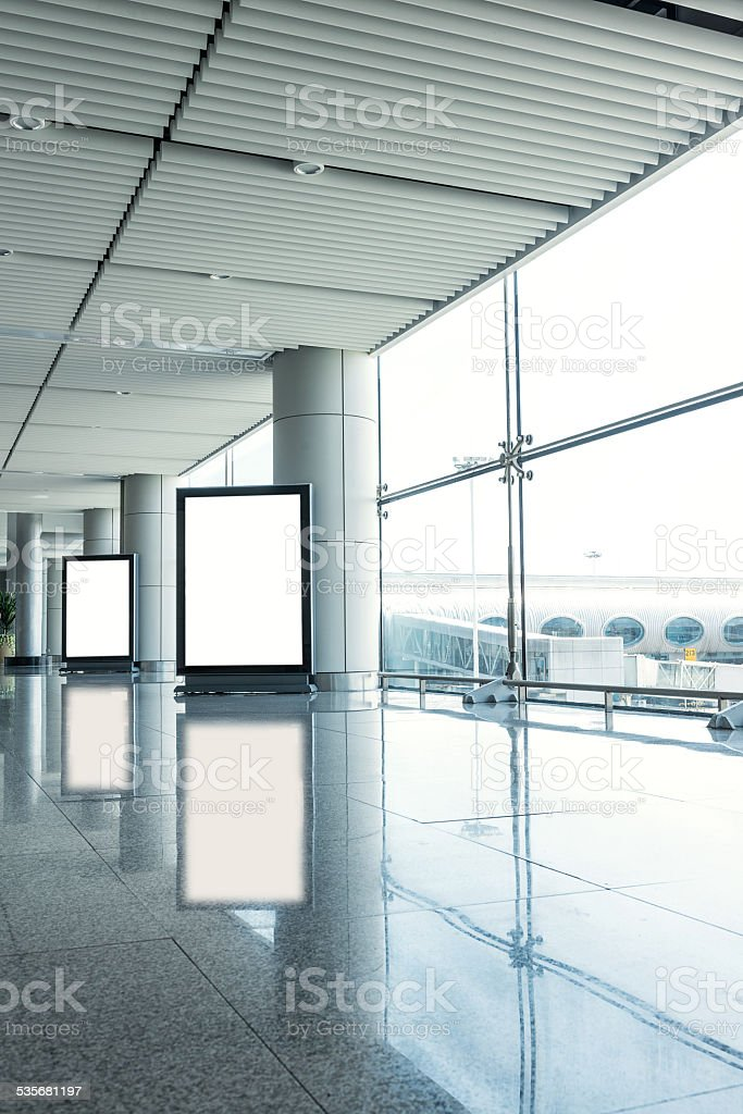 blank billboards in modern building corridor stock photo