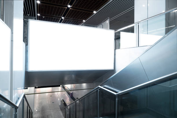 Blank billboards in modern city subway stations. stock photo