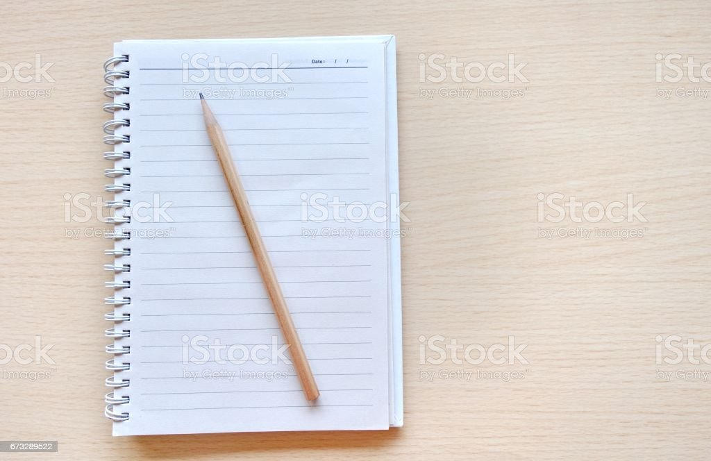 Blank binding notebook with pencil ob wooden background. royalty-free stock photo