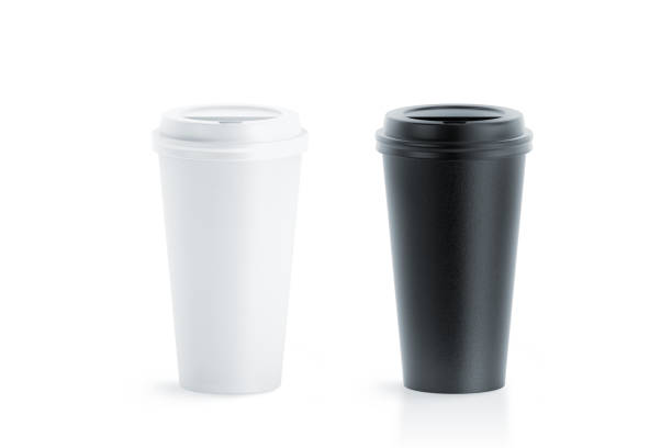 Blank black and white disposable paper cup with plastic lid stock photo
