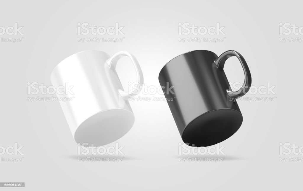 Blank black and white glass mug mockup isolated, no gravity stock photo
