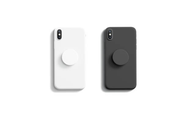Blank black and white pop sockets attached on mobile phone Blank black and white pop sockets attached on mobile phone mockups, isolated, top view, 3d rendering. Empty rubber popsocket holder on smartphone mock up. Clear round handle stick on cellphone. electrical outlet stock pictures, royalty-free photos & images
