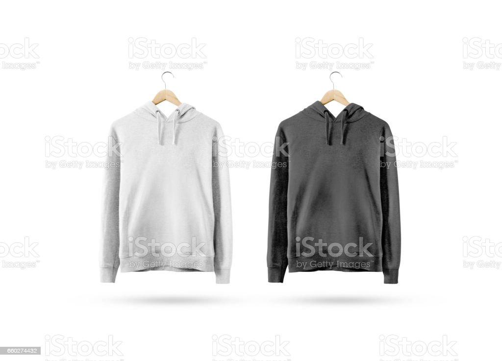 Blank black and white sweatshirt mockup hanging on wooden hanger stock photo
