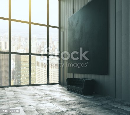 istock Blank black big picture above leather sofa 516177716