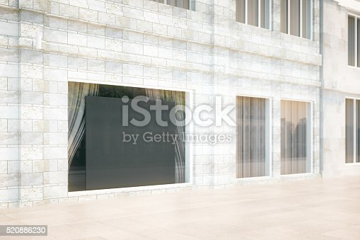 istock Blank black board in the window of building, mock up 520886230