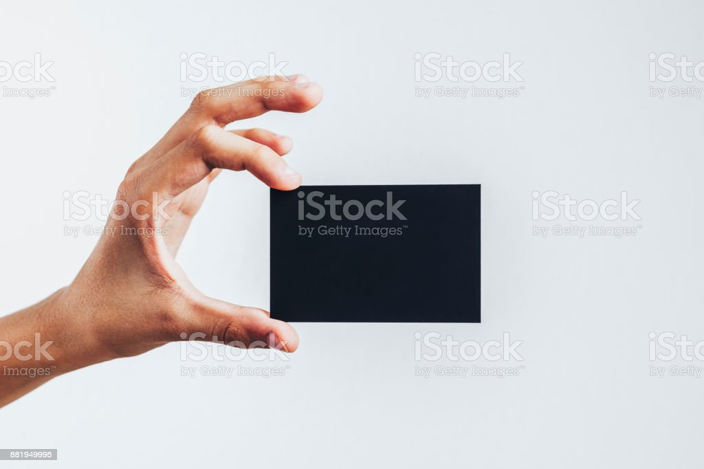 Blank black card in a hand stock photo