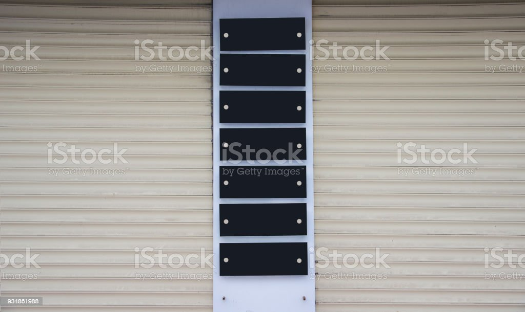 Blank black  company plates mounted on the wall stock photo