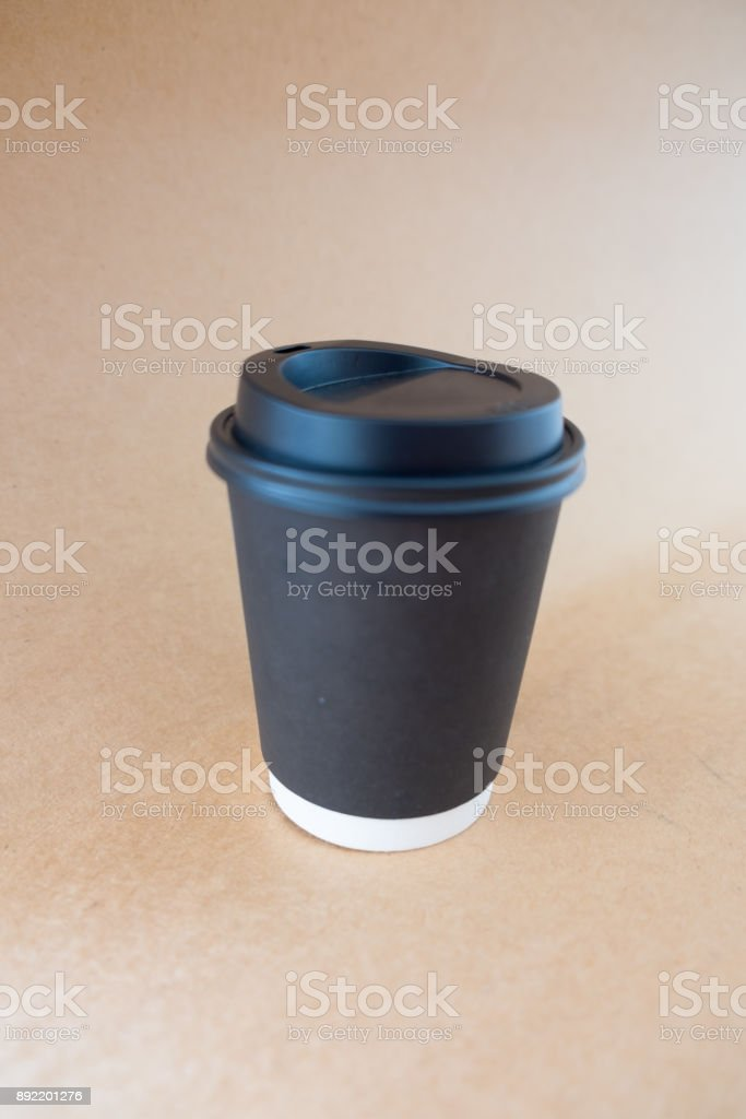 Blank black disposable paper cup with plastic lid