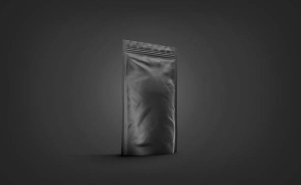 Blank black doypack mockup stand isolated on darkness background stock photo
