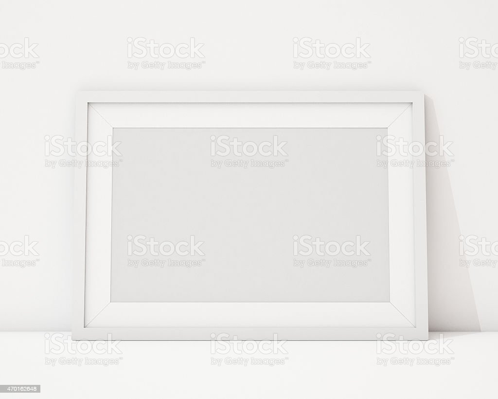 blank black horizontal picture frame on the wall stock photo