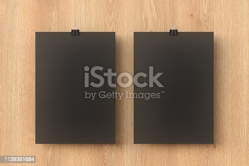 931839050 istock photo Blank black paper poster hanging on binder clip 1139361684