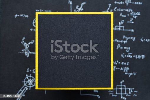 1148553584istockphoto blank black paper science equation blur background 1045529094