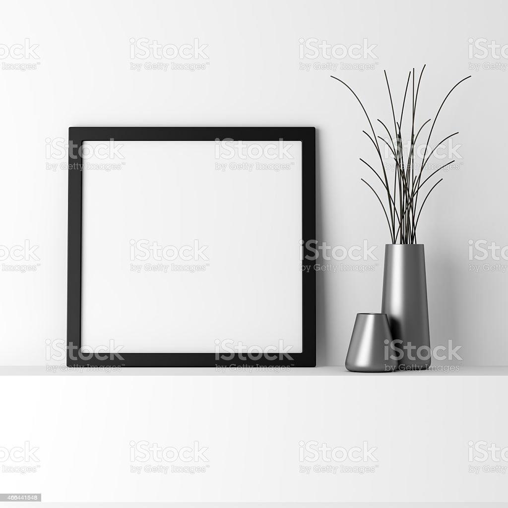 blank black photo frame on white shelf stock photo