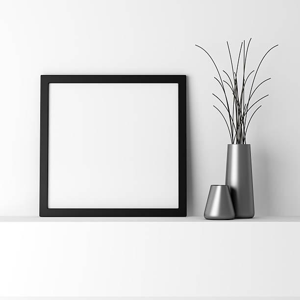 blank black photo frame on white shelf - 方形 個照片及圖片檔