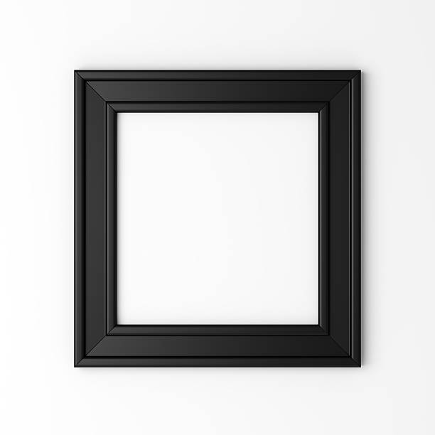blank black photo frame on white wall stock photo