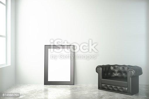 istock Blank black picture frame on concrete floor 514565254
