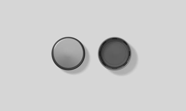 Blank black plastic bottle caps mockup set isolated Blank black plastic bottle caps mockup set isolated, front and back, top side view, 3d rendering. Empty mineral water lids mock ups. Fizzy pop circle clear cover design template. Soda drink element bottle cap stock pictures, royalty-free photos & images