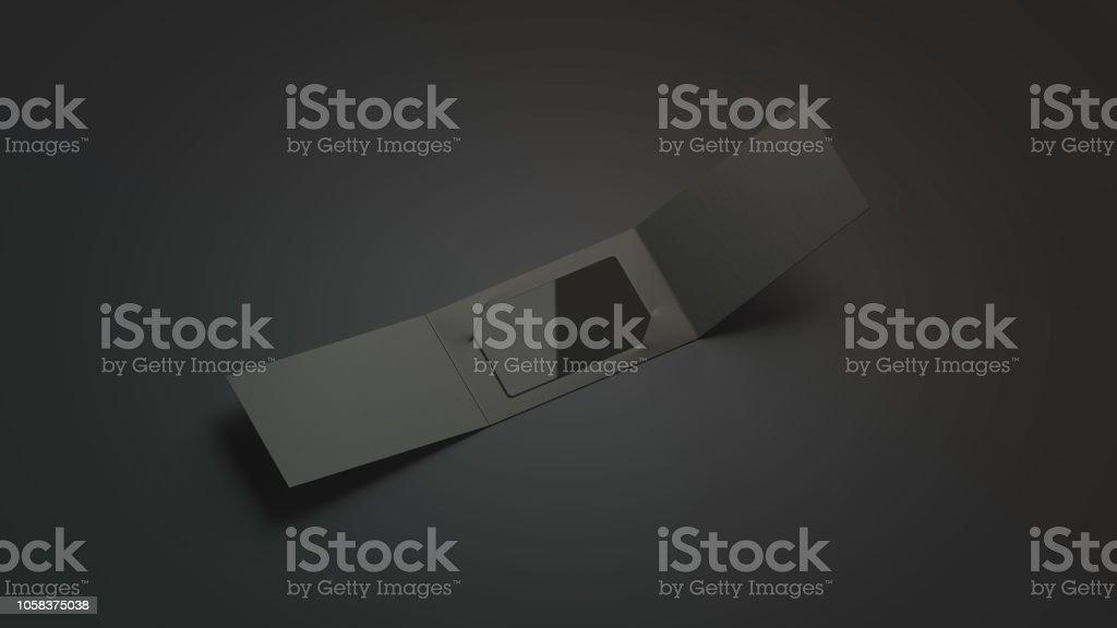 Blank black plastic card mockup inside opened paper booklet holder stock photo
