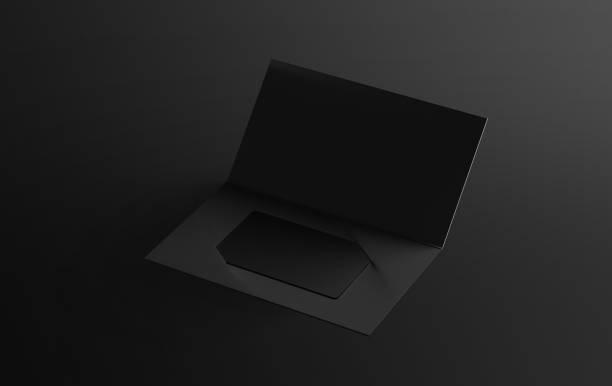 Blank black plastic card mockup inside paper booklet holder stock photo