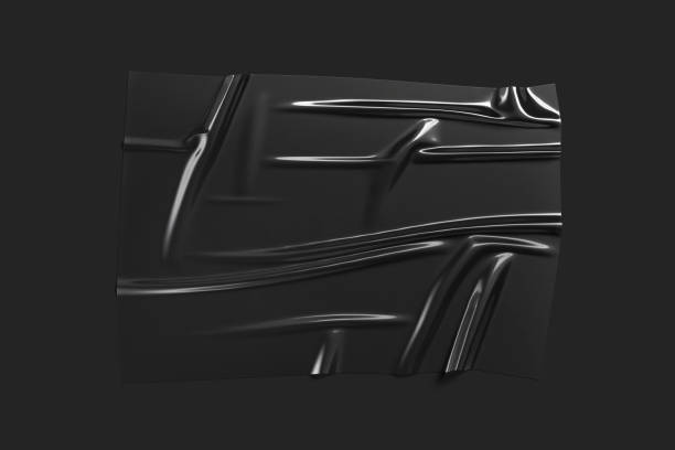 Blank black plastic foil wrap overlay mockup, dark background stock photo
