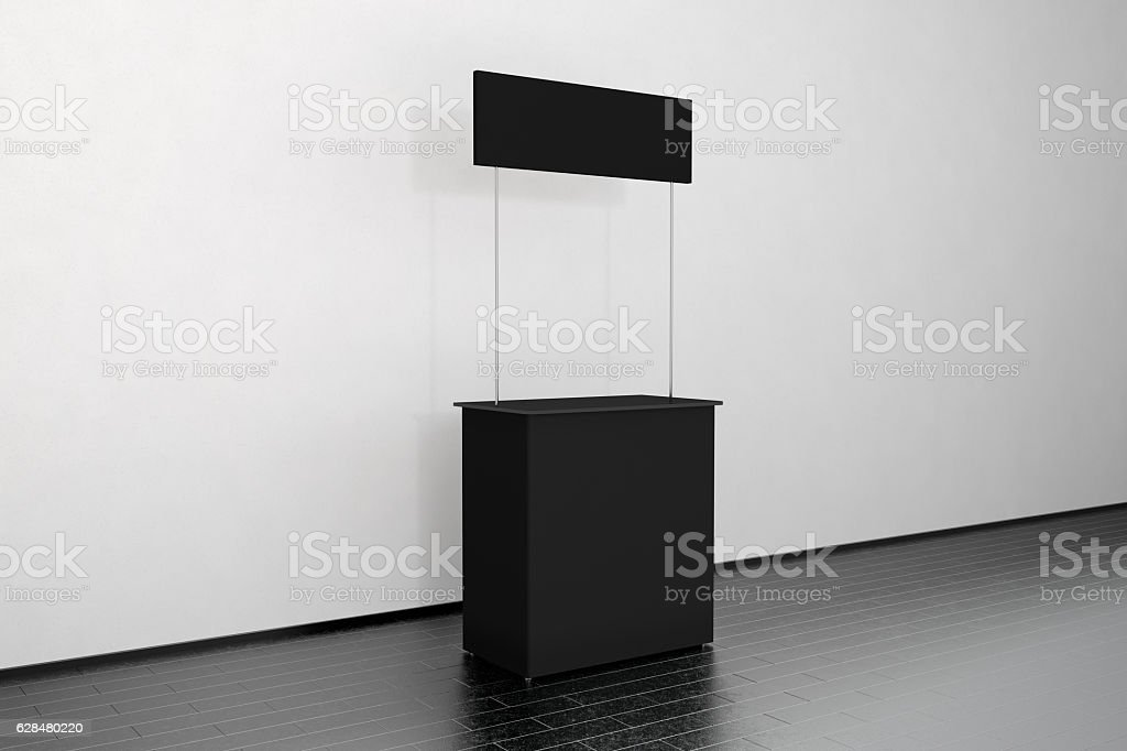 Blank black promo counter mockup stand near the wall, side stock photo