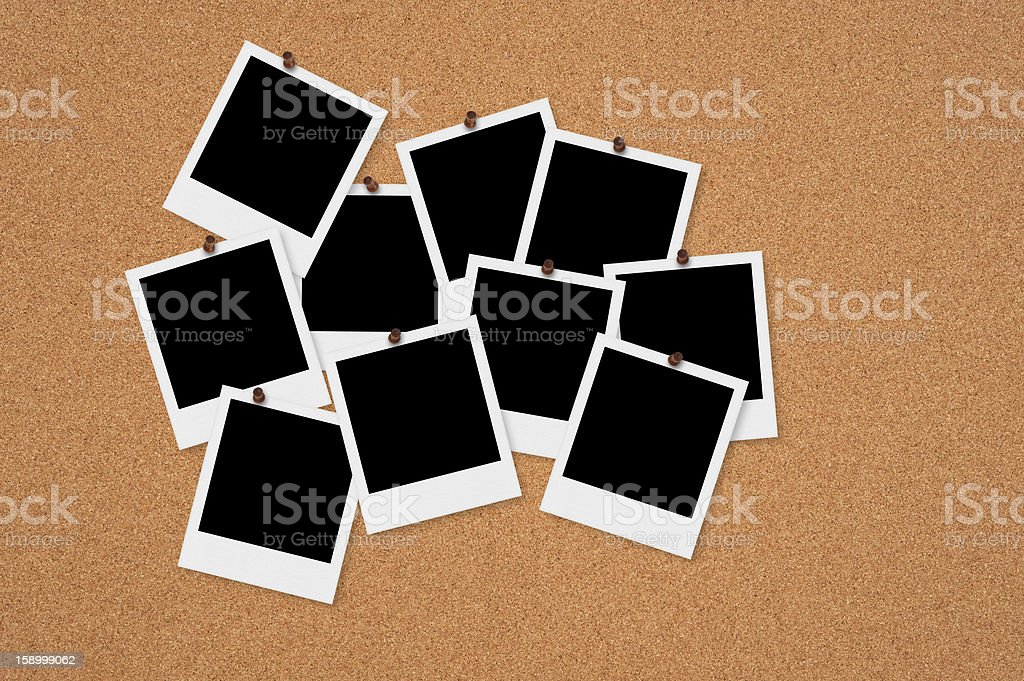 Blank black retro pictures pinned to a bulletin board royalty-free stock photo