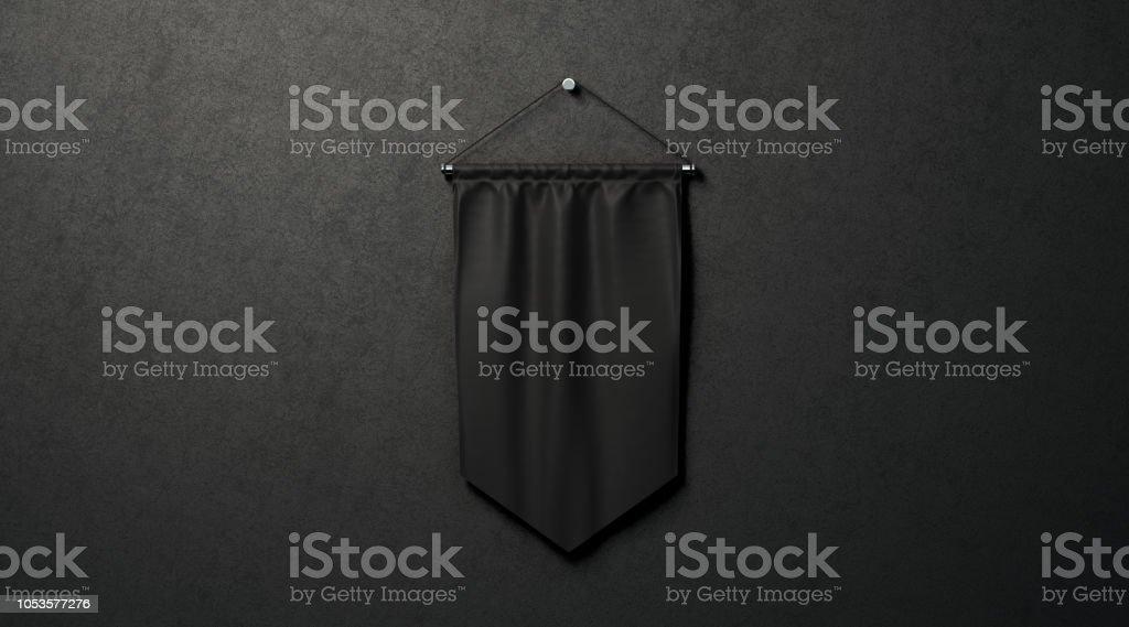 Blank black rhombus pennant mockup, near dark wall, stock photo