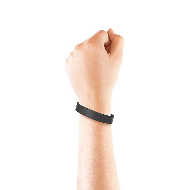 Blank black rubber wristband mockup on hand, isolated Blank black rubber wristband mockup on hand, isolated. Clear sweat band mock up design. Sport sweatband template wear on wrist arm.  Silicone fashion round social bracelet wear on hand. Unity band. wristband stock pictures, royalty-free photos & images
