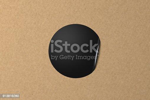 913812376 istock photo Blank black sticker with bent edge on black leather background. 3d illustration 913816280