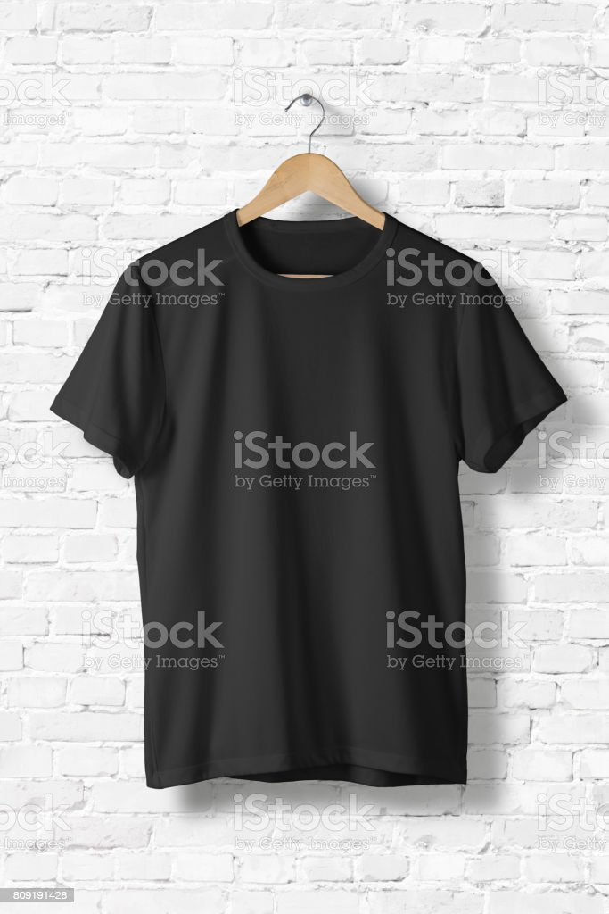 Blank Black T-Shirt Mock-up hanging on white wall, front side view . Ready to replace your design stock photo