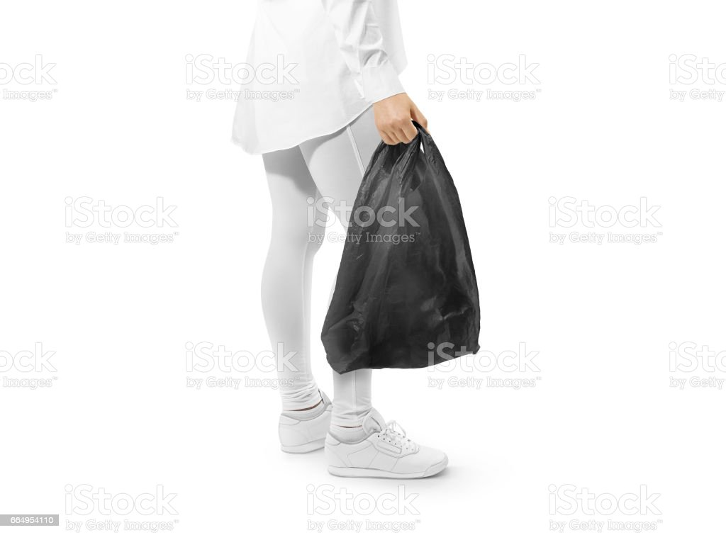Blank black t-shirt plastic bag mockup holding hand stock photo
