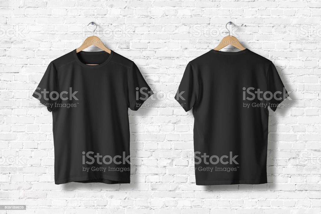 Blank Black T-Shirts Mock-up hanging on white wall, front and rear side view . Ready to replace your design stock photo
