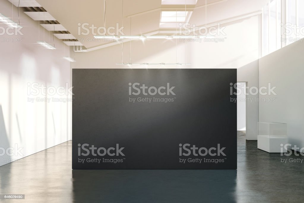 Blank black wall mockup in sunny modern empty gallery stock photo