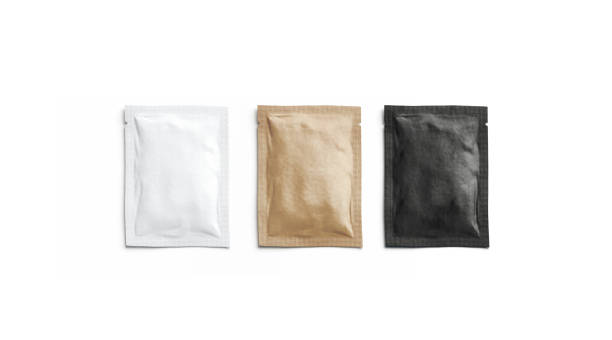 Blank black, white and craft paper sachet packet mockup, isolated Blank black, white and craft paper sachet packet mockup, isolated, 3d rendering. Empty kraft coffee packaging mock up, top view. Clear sealed wrapper for salt or pepper mokcup template. packet stock pictures, royalty-free photos & images