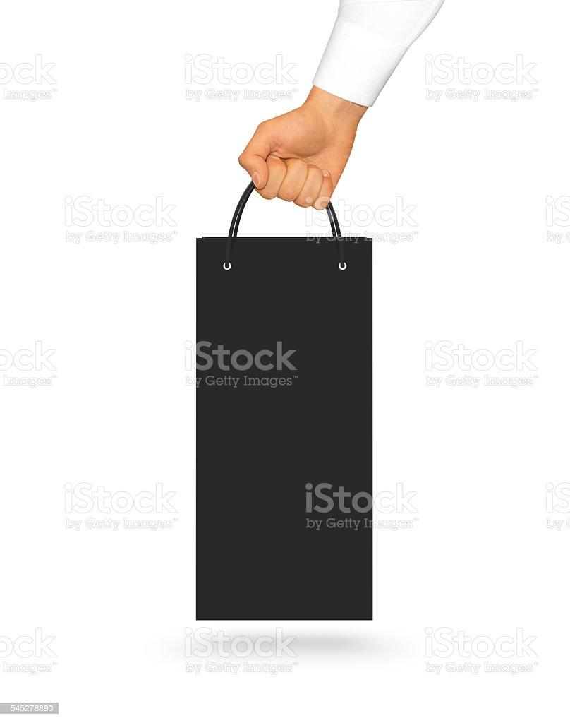 Blank black wine paper bag mock up holding in hand stok fotoğrafı