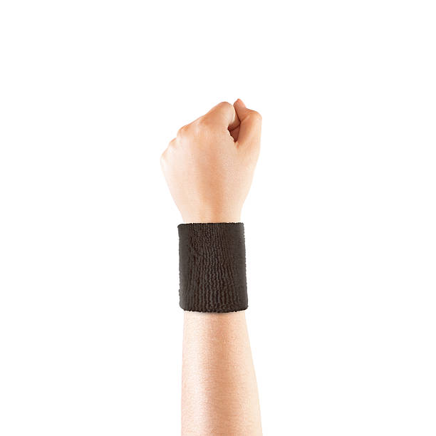 Blank black wristband mockup on hand, isolated Blank black wristband mockup on hand, isolated. Clear sweat band mock up design. Sport sweatband template wear on wrist arm. Sports support protective bandage wrap. Bangle on the tennis player hand. wristband stock pictures, royalty-free photos & images