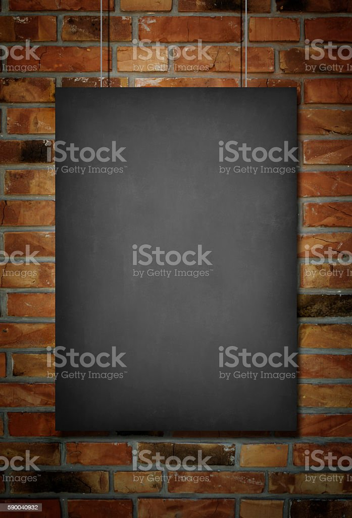 Blank blackboard at a brick wall background stock photo