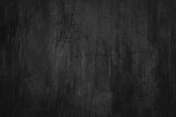 Blank blackboard background with scratches and dust. Detail of scratched chalkboard surface. stock photo