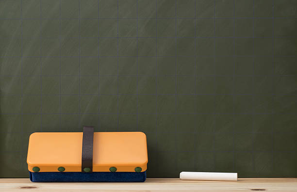 Blank blackboard with chalks and eraser stock photo
